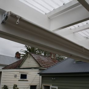 Under roof retractable shade